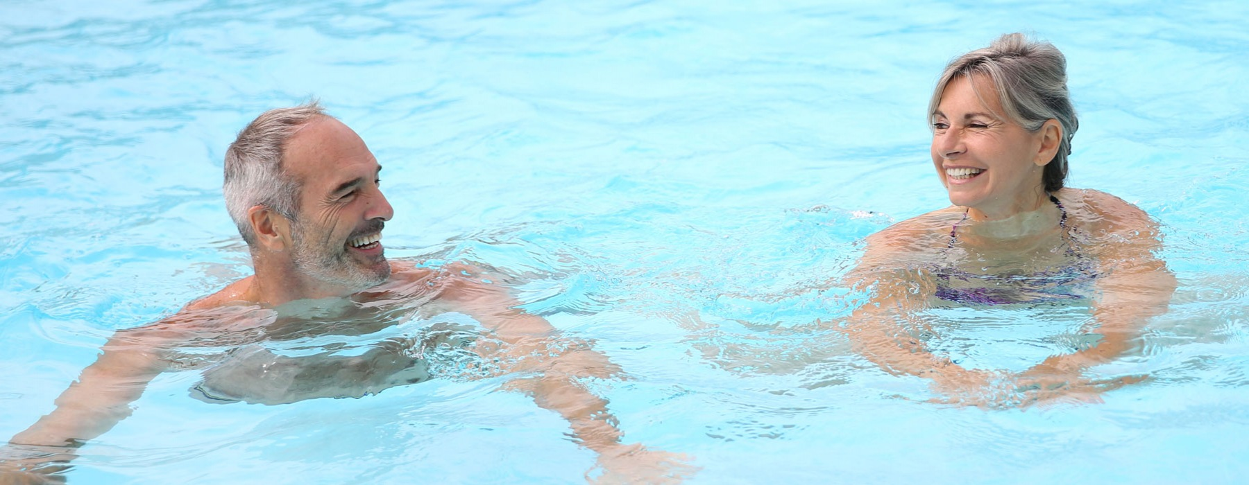 Couple swimming in a pool